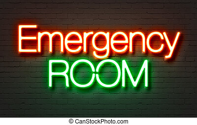Emergency room neon sign on brick wall background.