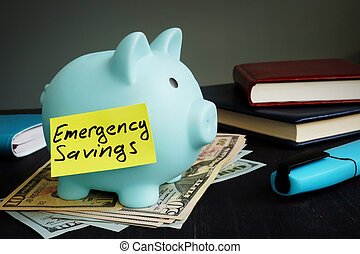Emergency savings sign on the blue piggy bank.