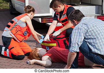 Emergency service helping woman - Emergency service helping...
