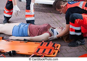 Emergency service taking woman