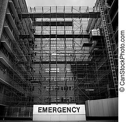 Emergency sign at a hospital with chaotic construction work going on