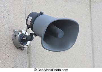 Emergency Siren fastened to an exterior wall.