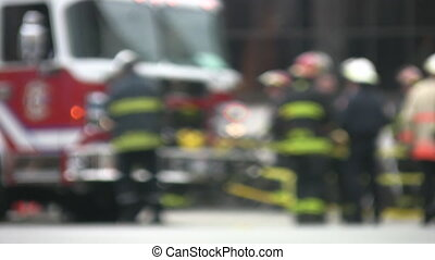 Emergency. - Firetruck and firemen at the scene of an...