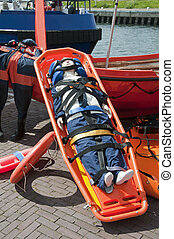 emergency stretcher with doll as a person for training