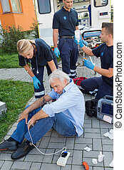 Emergency team giving help to injured man