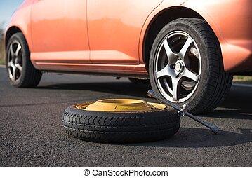 Emergency tyre on the road at breakdown
