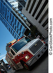 An Emergency Response vehicle on a busy city street.