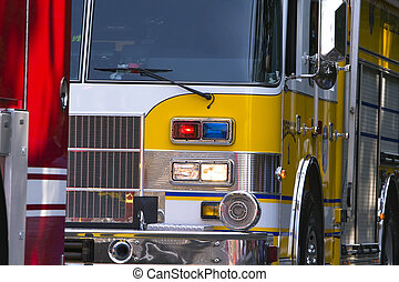 Close-up of section of two fire trucks.