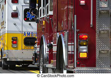 Emergency Vehicles - Several emergency vehicles lined up,...