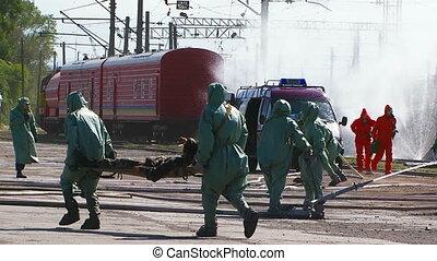 Emergency Workers Saving People And Watering Tanks At Railway