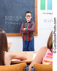 Eminent boy in front of class - Eminent math boy who solved...