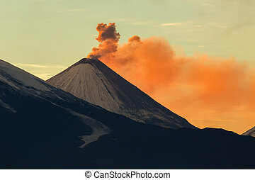 Emission ash from a volcano Klyuchevskoy dawn rays of the sun.