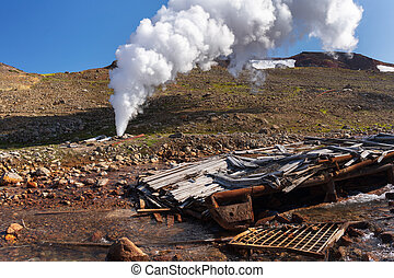 Emission of thermal steam-water mixture from well in geothermal deposit area