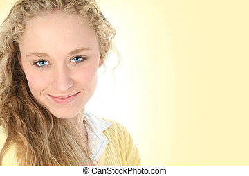 Beautiful young woman in pale yellow. Long curly blonde hair and blue eyes.