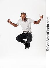 emocjonalny, skokowy, młody, afrykański człowiek