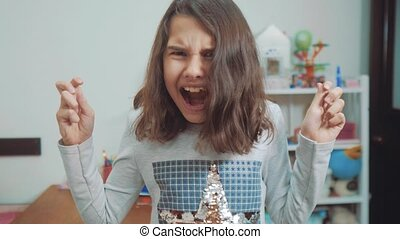 emotion depression concept children. Shocked panic little girl screaming in despair and frustration. girl teenager screams opened her mouth upset. slow motion video. Problems girl lifestyle crying concept