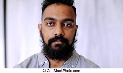 emotion, expression and people concept - happy smiling man with beard