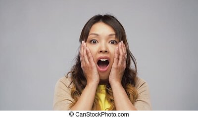 shocked asian woman with open mouth - emotion, expression ...