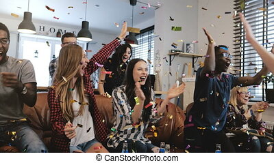 Emotion. Multi-ethnic fans celebrate winning. Confetti 4K...