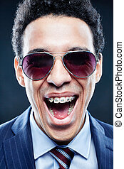 Emotion - Portrait of shouting man in sunglasses looking at...