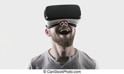 Emotion smile happy man wearing virtual reality goggles. VR headset. look up