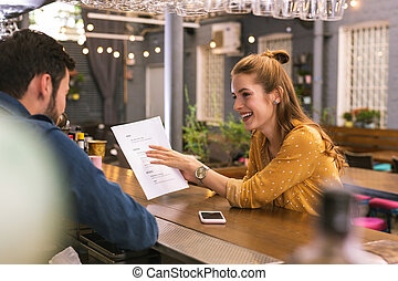 Emotional actress showing her play to the barman and smiling