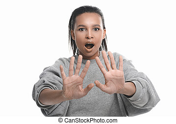 Emotional african american woman gesturing with hands and looking at camera