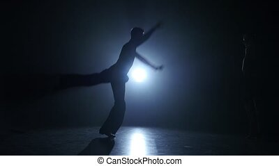Emotional and graceful Paso Doble dance performed by champions, smoky