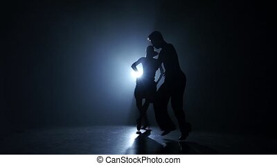 Emotional and graceful salsa dance performed by champions, smoky studio