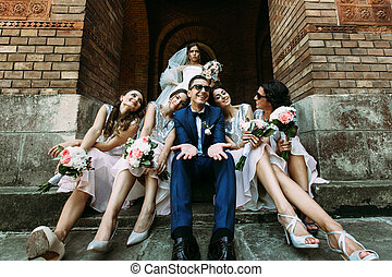 Emotional bride and groom with the bridesmaids