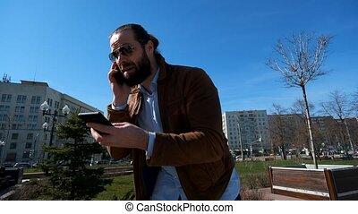 Emotional businessman irritably talking on the phone