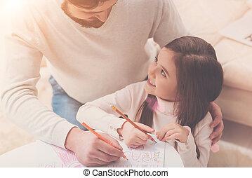 Emotional charming girl talking to her dad