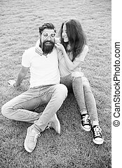 Emotional couple radiating happiness. Love story. Couple relaxing green lawn. Happy together. Couple in love cheerful youth booth props. Man bearded hipster and pretty woman in love. Summer vacation