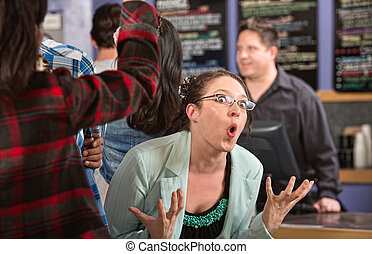 Emotional Customer in Cafe - Emotional white female customer...