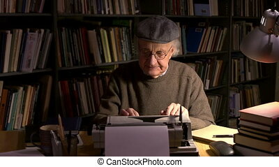 Emotional discharge - Aged man printing a book happy being...