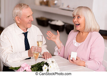 Emotional elderly lady excited about proposal