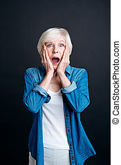 Emotional elderly woman looking at you