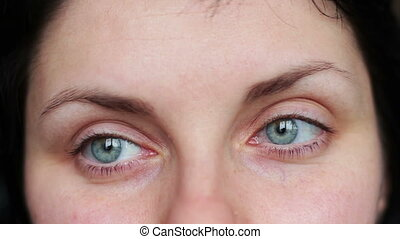 Emotional face of a beautiful green-eyed young girl