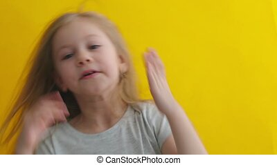 Emotional girl after making mistake on yellow background - ...
