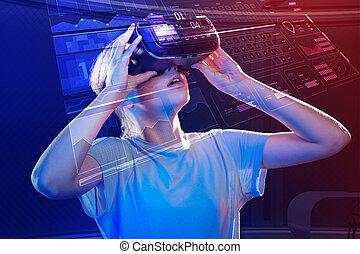Emotional girl feeling impressed while wearing virtual reality device