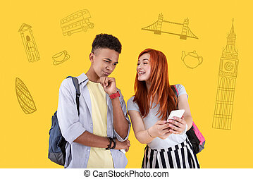 Emotional girl showing popular places on the smartphone and her friend thinking