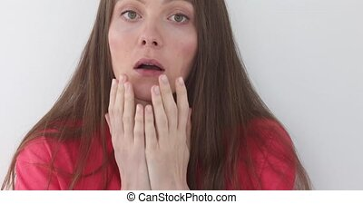 Emotional girl shows a frightened gesture - Emotional girl...