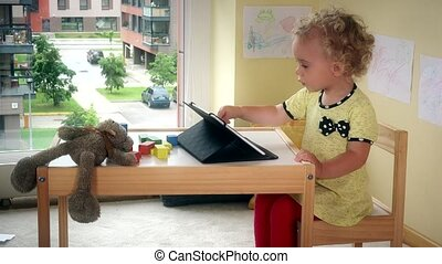 Emotional girl using tablet computer. True emotions. Poor...