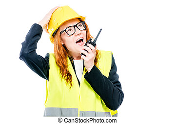 Emotional girlfriend foreman with a walkie-talkie in his hand screams on a white background