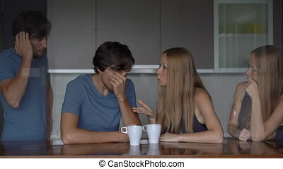 Emotional intelligence concept. Young couple analyzes their previous quarrel. Side man and woman are half transparent.