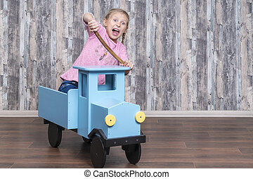 Emotional kid plays with a truck - Emotional girl sitting in...