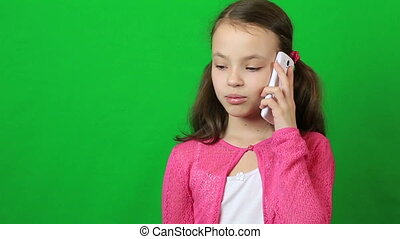 Emotional little girl talking on a smartphone.