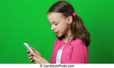 Emotional little girl talking on Skype at phone. - Emotional...