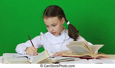 Emotional little girl tears spoiled paper. Child doing homework.