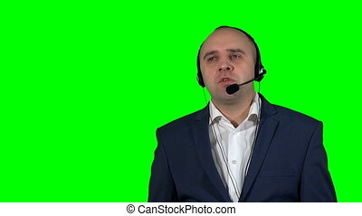 Emotional man in call center isolated on green background
